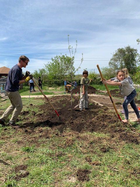 Volunteers building a garden at APG